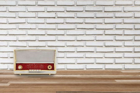 white wood floor: interior wood floor and white brick wall with old radio, vintage background