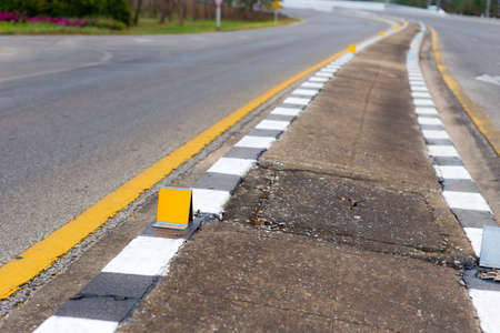 curve road: curve road and reflextive marking on footpath