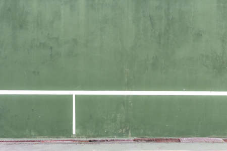 knock: tennis knock board, green concrete wall with net line for training Stock Photo
