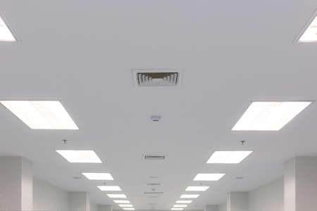 ceiling and fluorescent lighting with exhaust fan louver smoke detection and fire water sprinkler, selective focus