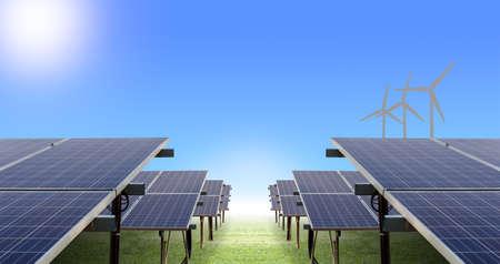 solar farm: solar farm and wind turbine on ground and blue sky, concept of sustainable living