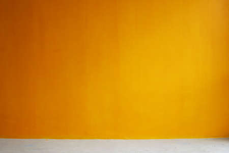 orange painted wall with concrete floor, interior background Stock Photo