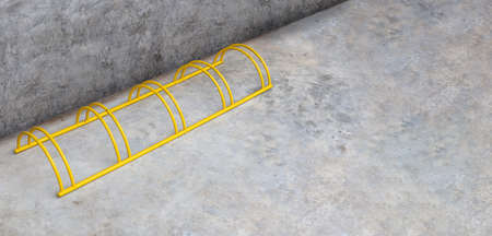 old yellow bicycle rack parking on concrete floor and wall