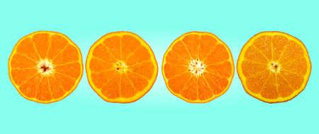 slice of orange fruit  on ocean green color background Stock fotó