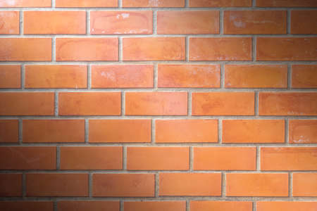 brown brick wall background with light and shadows , industry construction concept