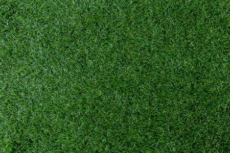 fond de texture d'herbe verte artificielle, vue de dessus