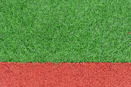 red rubber playground and artificial green grass, children activity abstract background Stock fotó