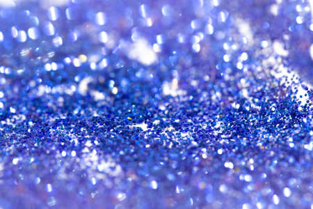 blue glitter and bokeh background, selective focus