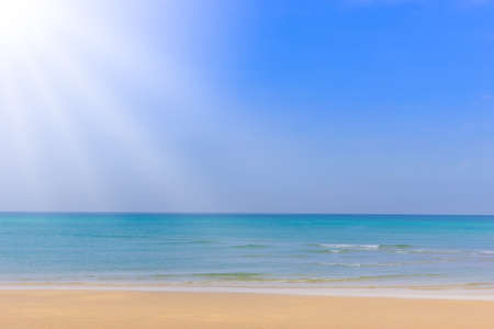 sea sand and sun with ray righting,blue sky,  summer holiday concept background Reklamní fotografie