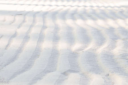 sand beach nature background, abstract pattern after sea water reduction