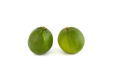 green limes isolated on white background with water drop, and shadow
