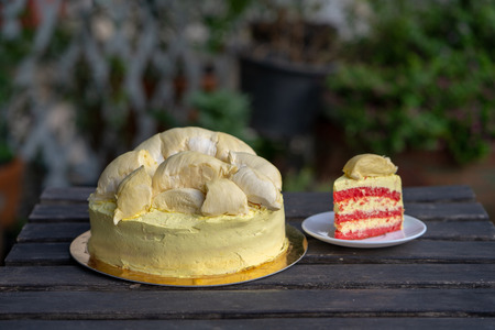 Durian cake and fresh yellow durian, Homemade Bakery in thailand, using as a background or wallpaper and text Standard-Bild - 107320588