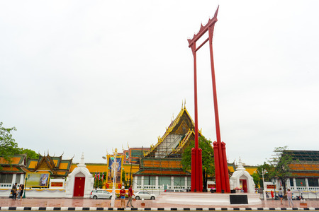 BANGKOK, THAILAND - August 02, 2018 : The Giant Swing and Wat Suthat Temple Bangkok, Thailand.Young asian woman traveling to landmark in Bangkok Thailand.