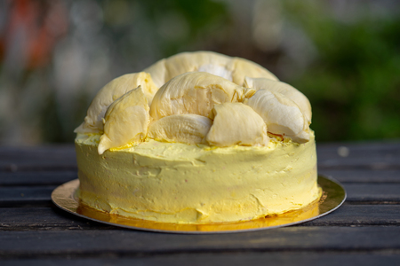 Durian cake and fresh yellow durian, Homemade Bakery in thailand, using as a background or wallpaper Standard-Bild - 107320782