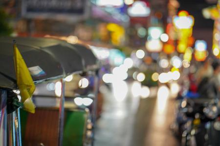 blurred defocused tuk tuk on thailand street market abstract background