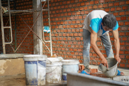 Close up of industrial bricklayer installing bricks on construction site in thailand Standard-Bild - 107269320