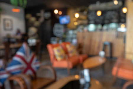 Pixelation effect of Coffee shop blur background with bokeh image, using as a background or wallpaper Standard-Bild
