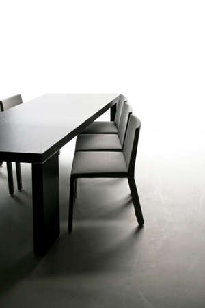 dining table and chairs: Black table with chairs in dinning room