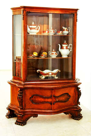 fine wood: Old wooden cabinet with fine china porcelain Stock Photo