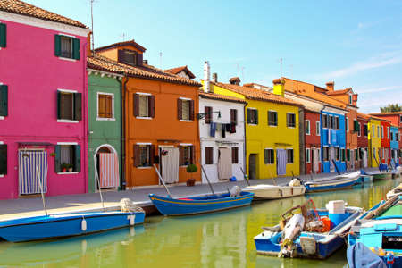 burano: Colorful buildings in Burano island sunny street  Stock Photo