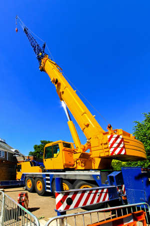 pivot: Big and yellow construction crane for heavy lifting  Stock Photo