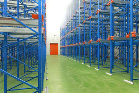 empty warehouse: Empty blue shelves in new distribution warehouse Stock Photo