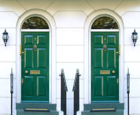 Symmetric photo of two front doors in typical London street photo