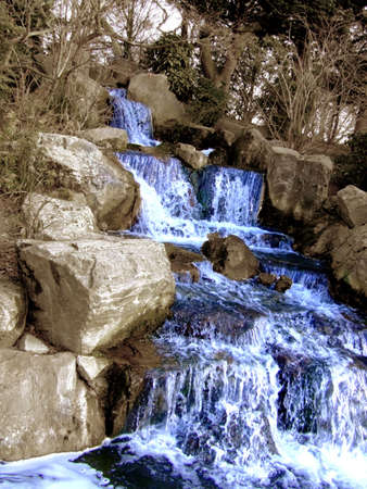 Big grandiose waterfall with plants in the nature photo