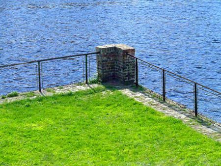 Green grass and blue water Stock Photo - 394123