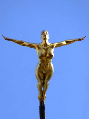 Gold art statue of naked woman
