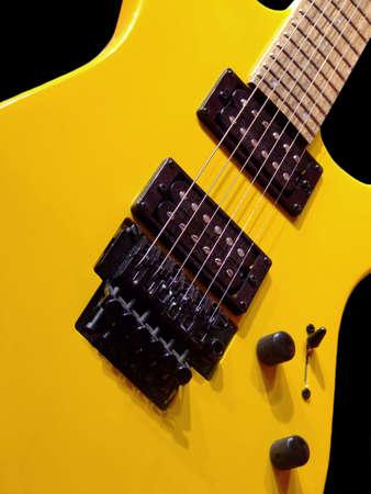 Yellow electric guitar detail
