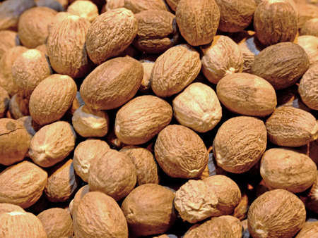 Close up of pile of nutmegs Stock Photo