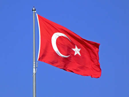 flaunt: Turkish flag on a wind with sky in background