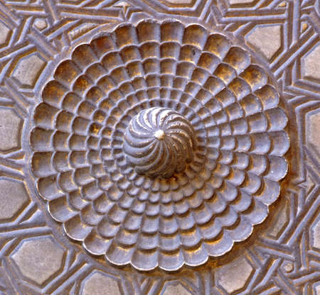 engravings: Detail of engraving in marble flower shape Stock Photo