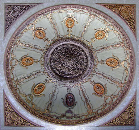Gold circle ornament on a round ceiling photo