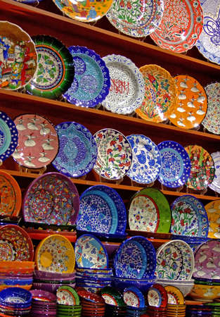 Bunch of colorful pottery handicrafts in the shop photo