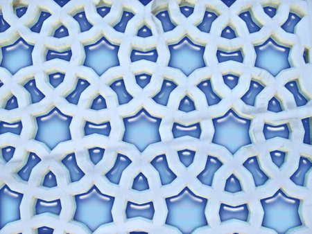 Marble flower pattern on mosque window Stock Photo