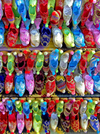 Several rows of colorful ethnic shoes on display photo