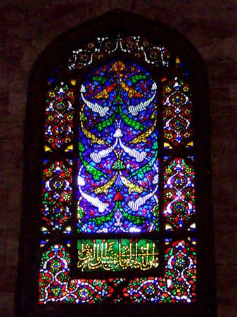 Colorful glass on the mosque window from inside