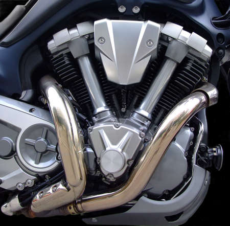 horse pipes: Powerful old style motorcycle V engine Stock Photo