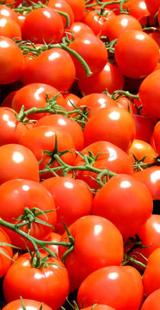 Close up of red tomatoes on an open market Stock Photo