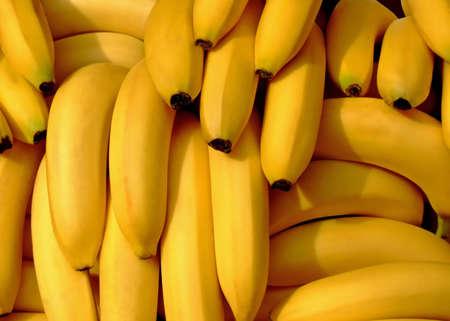 Pile of fresh organic bananas on a market