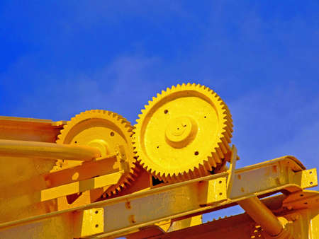 Yellow gears on a crane detail photo