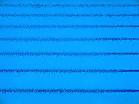 deflect: Trembling surface of an sports competition size swimming pool with parallel stripes