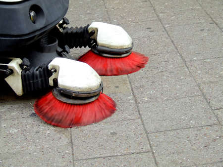 Street cleaning machine with red brushes 写真素材