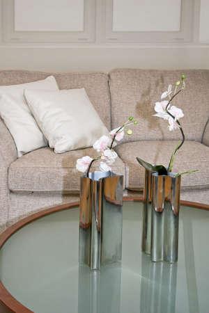Two metallic vases on the glass table Stock Photo - 2105556