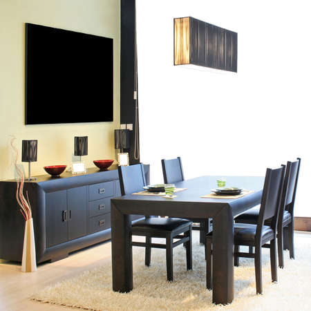 Modern dinning room with black table and closet Stock Photo - 2415981