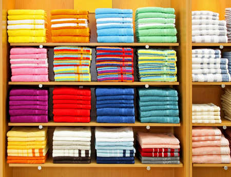 Big shelf with bunch of colorful towels photo