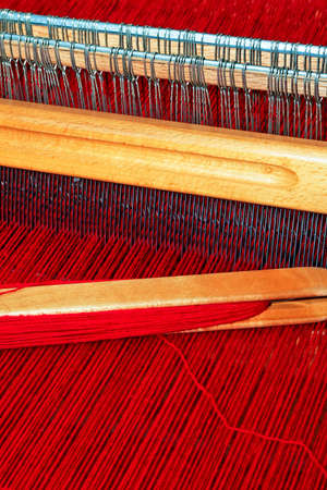 loom: Close up shot of loom with red thread