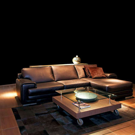 divan sofa: Classic brown leather sofa in living room